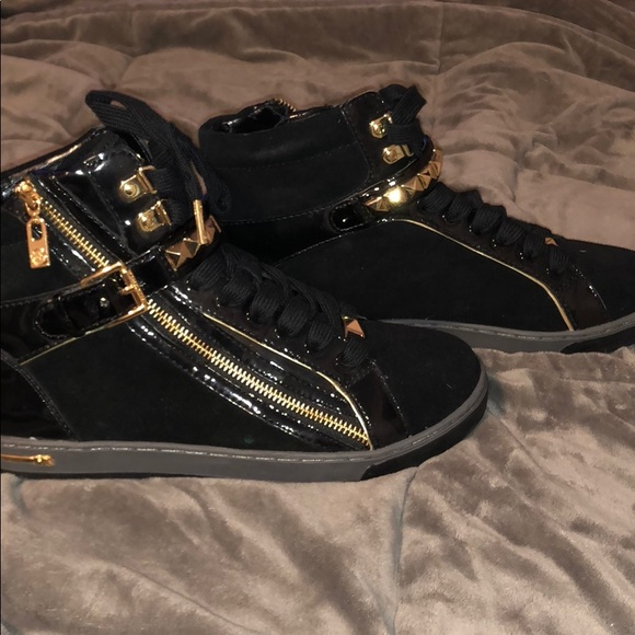 b2cf0be08282 Michael Kors black and gold high top sneakers. M 5b84bfcd7ee9e2fae47516ab